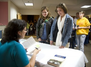 "Sonia Nazario signs copies of ""Enrique's Journey"" after her lecture."