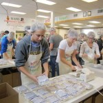 Members of Gustavus Greek organizations pack meals during a Kids Against Hunger event.