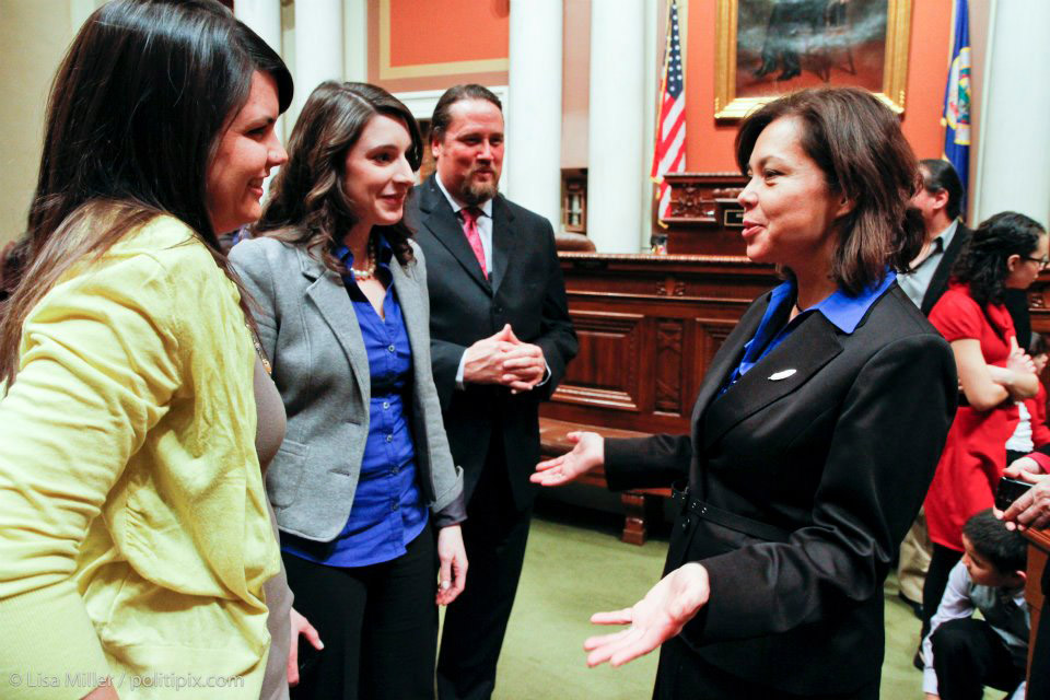 Meagan Bachmayer '08 (second from left) on the floor of the Minnesota House with Susan Allen (right), the first American Indian woman to serve in the Minnesota legislature (Photo courtesy of Lisa Miller Photography & Design).