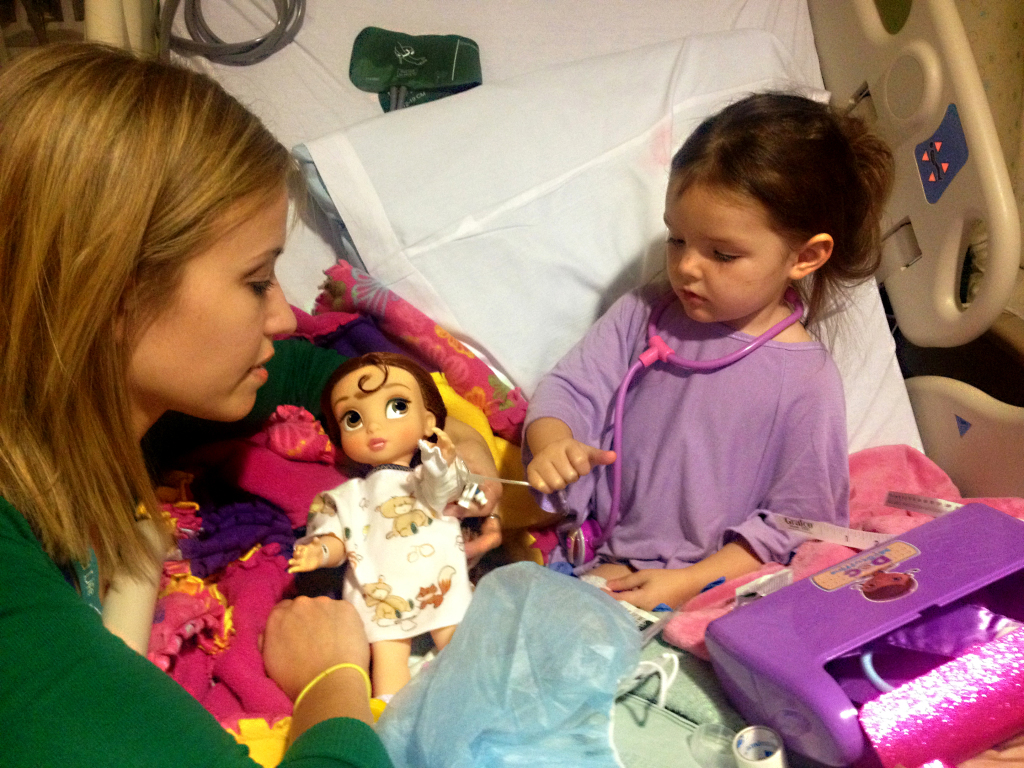 Annika Johanson works with a patient at Children's Hospital.